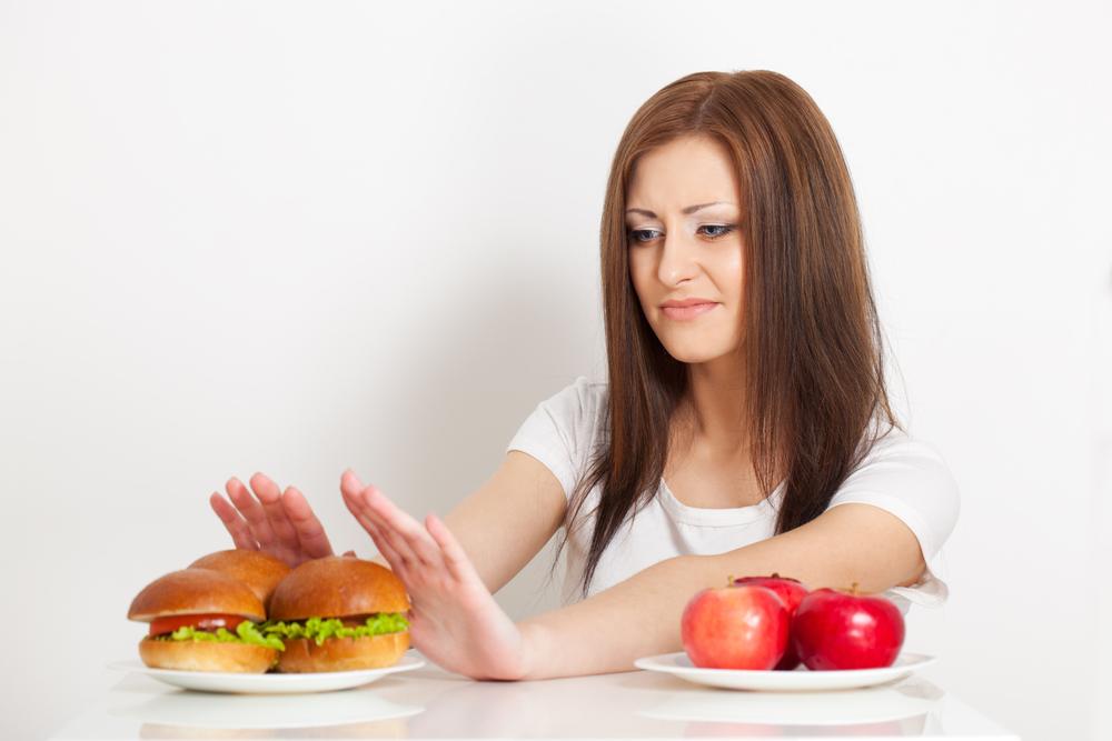 Почему перед месячными и во время них болит желудок и кишечник, в чем причина болей в животе?