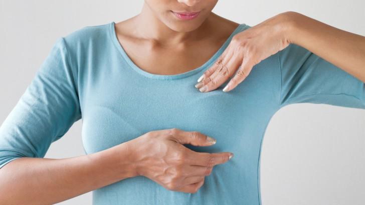 Болит и набухает грудь после месячных, тянет низ живота: почему так бывает, опасно ли это и что делать?