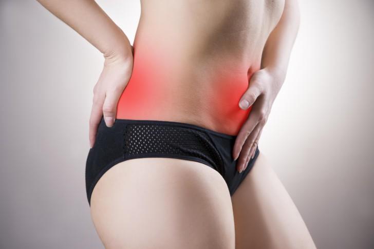 Почему у женщин перед месячными болит низ живота, в чем причина болей, если менструация уже прошла или до нее далеко?